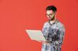 Leinwanddruck Bild - Male programmer with laptop on color background