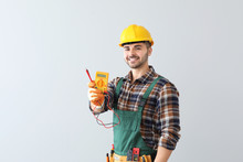 Male Electrician On Light Background