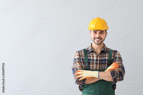 Fotografia  Male worker on light background