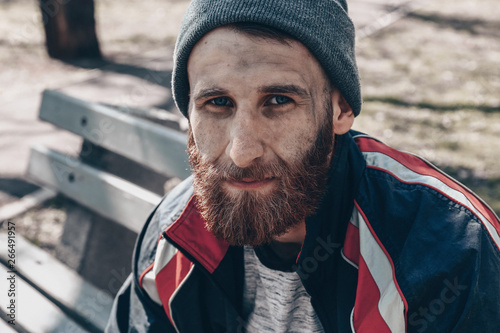 Obraz na plátně Poor homeless man sitting on bench outdoors