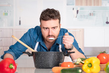 Man Is Cooking In His Kitchen And Adding Ingredient