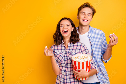 Close up photo of couple with pop corn he him his she her lady boy laughing o...