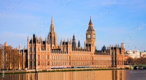 Palace of Westminster over sunny blue sky #266496343