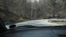 Car Going Down A Mountain Road
