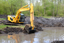 Big Powerful Excavator Digging Drainage Channel In Swamp In Countryside