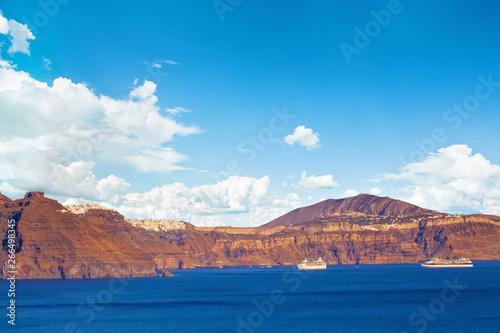 Santorini caldera, Mediterranean sea and sky clouds