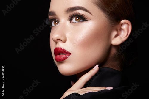 Fototapeta Brunette girl with red lips