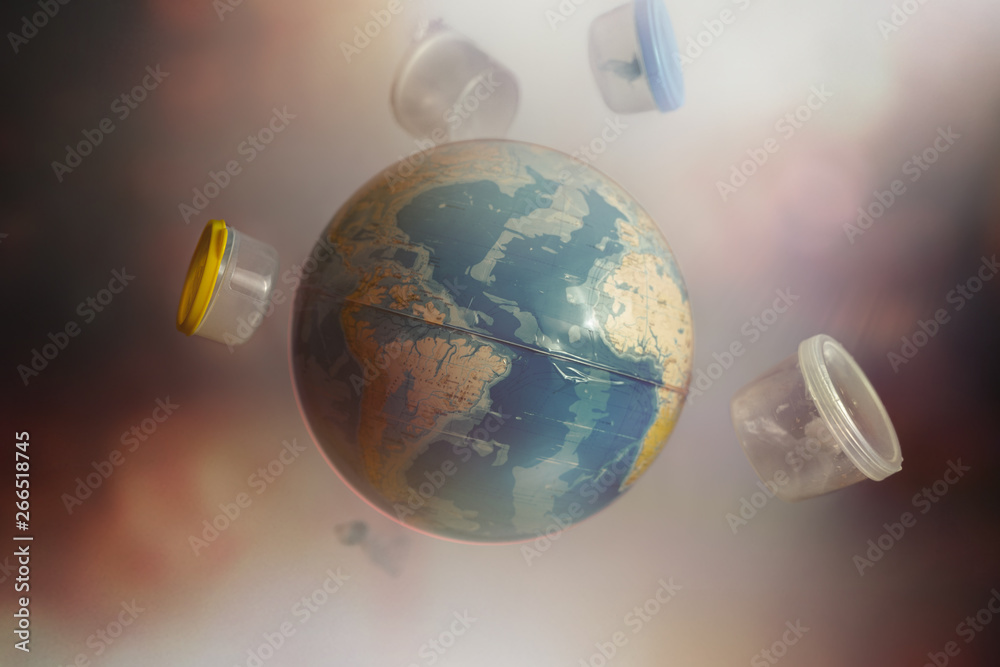 Fototapety, obrazy: Globe of Planet earth surrounded by plastic bottles and garbage.The concept of ecology and environmental pollution