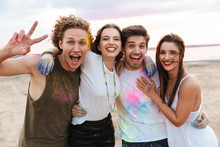 Group Of A Cheerful Young Friends Having Fun At The Beach