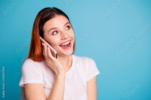 Deurstickers Wanddecoratie met eigen foto Close-up portrait of her she nice attractive lovely winsome cheerful cheery girlish glad girl wearing white tshirt holding in hand device gadget discussing news over bright vivid shine blue background
