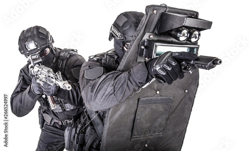 Fotografija SWAT team behind ballistic shield studio shoot