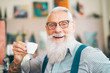 canvas print picture - Happy senior drinking coffee in bar - Hipster older male having coffee break - Lifestyle people concept