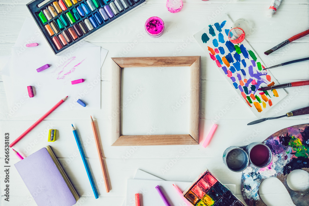 Fototapety, obrazy: Top view Bright workplace of creative artist mockup. Blank canvas surrounded by variety of drawing supplies. Art, workshop, painting, drawing, inspiration, craft, creativity concept. Art therapy,