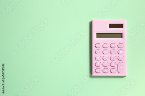 Cuadros en Lienzo Pink digital calculator on green background