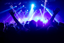 Silhouette Of Man With Raised Hands On Music Concert