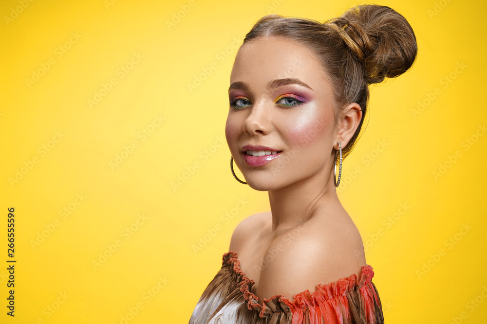 Fototapety, obrazy: Pretty girl with colorful makeup posing on yellow background