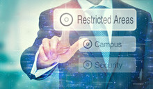A Business Man Selection A Restricted Areas Button On A Futuristic Display With A Concept Written On It.