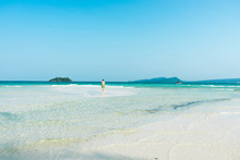Man Standing On Sand Bank At K...