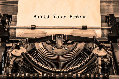 Fotomural  BUILD YOUR BRAND printed on a sheet of paper on a vintage typewriter