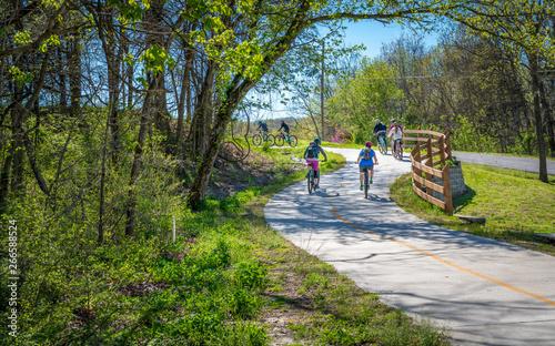 Family with kids biking on bike trail in Bella Vista, Northwest Arkansas Canvas Print