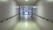 Steadicam shot rolling down hospital hallway