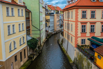 Fototapeta na wymiar water channel with river of Certovka (Devil's Channel), also called Little Prague Venice, in district of Lesser Town (Mala Strana) Prague, Czech Republic, Europe