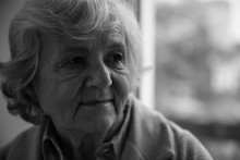 Portrait Of Elderly Woman Indoors, Space For Text. Black And White Effect
