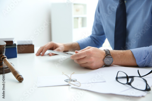 Photo  Notary working with tablet at table in office, closeup