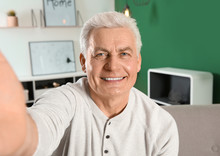 Mature Man Using Video Chat At Home, View From Web Camera