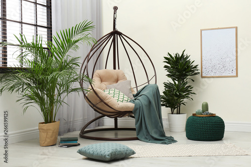 Valokuva  Stylish modern room interior with swing chair