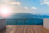Fototapeta  - Balcony view of  mountains. Landscape. Sunny Day. Terrace with a beautiful view. Background with beautiful landscape.