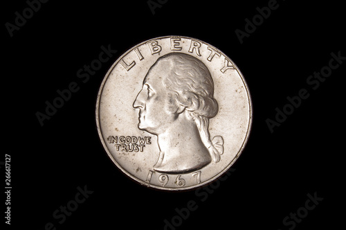 Fotografia  Shinny quarter dollar coin of United States of America USA isolated on the dark