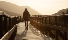Woman Walking On The Pier