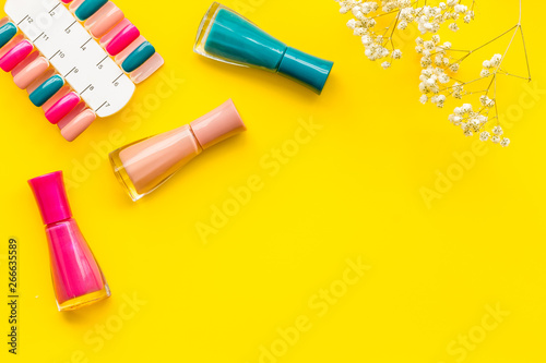 Fotomural cosmetics for manicure with nail polish and palette for spring design in nail ba