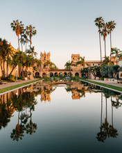Reflections In The Lily Pond And Historic Architecture At Balboa Park, In San Diego, California