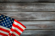 Memoral day of United States of America with flag on gray wooden background top view mock up