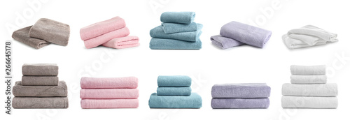 Fotografiet Set of folded soft terry towels on white background
