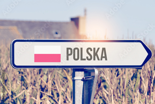 Obraz Ein Schild weist auf die Richtun nach Polen hin - fototapety do salonu