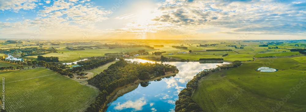 Fototapety, obrazy: Sun setting over scenic Australian countryside grasslands and pastures with river passing through - aerial panorama