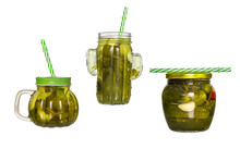 Three Glass Jars With Lids And Tubules With Cucumber Pickle Isolated On White Background