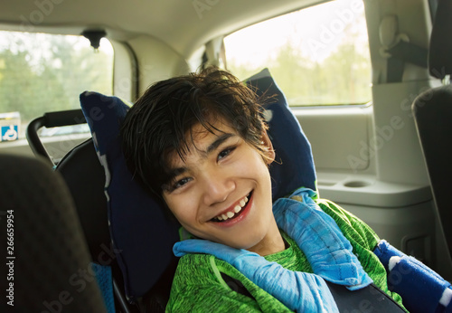 Obraz Young disabled boy in wheelchair traveling in handicap vehicle - fototapety do salonu