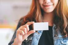 A Beautiful Woman Holding And Showing A Blank Empty Business Card To Someone