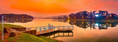 Foto auf Leinwand Rotglühen Sunrise over Xuan Huong Lake, Dalat, Vietnam. Panorama