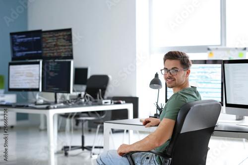 Fotografia  Portrait of male programmer in office