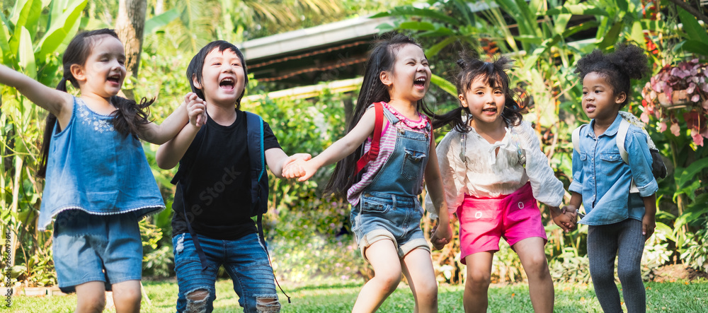 Fototapety, obrazy: Group of diversity kids holding hands and playing at outdoor park with happy and funny