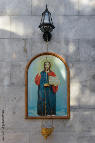 Valokuva Orthodox icon and censer on the marble wall