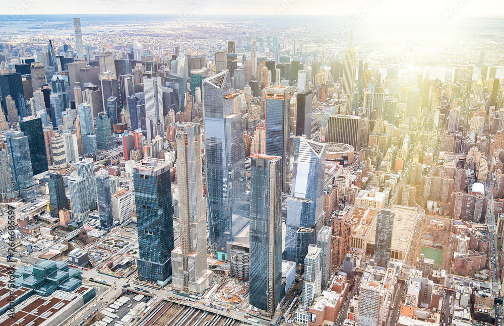 Fototapety, obrazy: New York City from helicopter point of view. Midtown Manhattan and Hudson Yards on a cloudy day