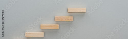 Fototapety, obrazy: panoramic shot of wooden blocks symbolizing career ladder isolated on grey