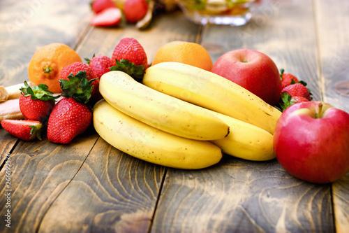 Fresh organic fruit, healthy vegetarian food on rustic table - 266699576