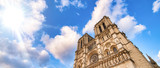 Notre Dame majestic facade against a beautiful blue sky - 266700362